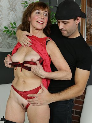 Sexy Amy takes a young cock
